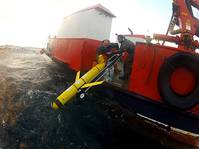 Submarine glider being deployed by RN personnel (Photo: NOC)