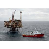 The Acergy Petrel alongside the Forties Bravo platform undertaking pipeline survey and inspection works. CREDIT: Apache corp.