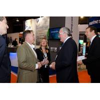 Both Professor Sir Jim McDonald and Fergus Ewing MSP (seen here meeting in the aisles at All-Energy 2014) will be amongst the opening plenary session speakers on 6 May.