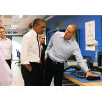Rod Washington, Sr. Development Engineer, Vacon Inc. demonstrates AC drive energy efficiency principles to President Obama. Behind (left), Dan Isaksson, Vice President, Medium Voltage Drives, Vacon, and Dr. Ernest Moniz, United States Secretary of Energy.