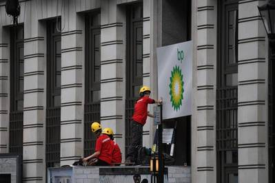 Activists blockade entrances to the BP headquarters in London, demanding an end to new oil and gas exploration. The campaigners arrived at 3 a.m. on Monday and encased themselves in heavy containers before the oil company's annual general meeting on Tuesday. Other activists are also climbing the building to hang signs from the windows. (© Chris J Ratcliffe / Greenpeace)