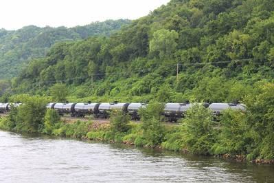 A crude oil train segment rumbles alongside a U.S. inland waterway. CREDIT: Dagmar Etkin
