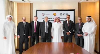Qatargas CEO Khalid Bin Khalifa Al-Thani (fifth from Left), United Arab Shipping Company CEO Jorn Hinge (fourth from  Left), and Managing Director and Chairman of Qatar Shell Companies, Michiel Kool (sixth from left) pose for a photograph along with other officials after the signing ceremony